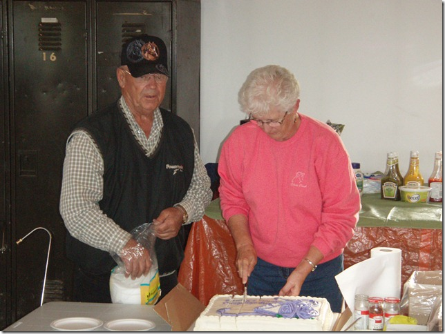 Uncle Brent and Helen cutting the cake