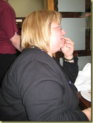Leigh with a mouthful of chocolate pud!