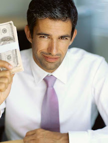 Business man holding up a stack of dollar bills.