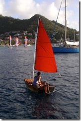 Anne sailing our dinghy around the anchorage in Les Saintes