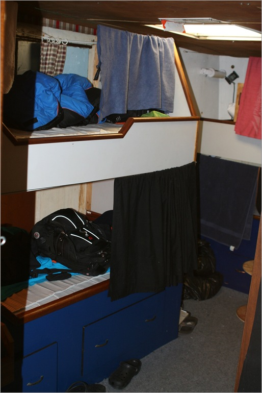 That is my rack on top and to the left. I have three roommates in this stateroom.