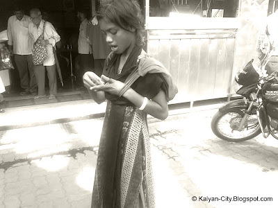Girl Child Beggar Counting Money