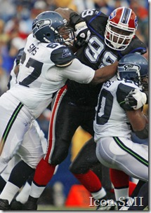 07 September 2008: Seattle Seahawks guard Rob Sims (67) tries to block for running back Maurice Morris (20), but is wrapped up by  Buffalo Bills defensive tackle Marcus Stroud (99) at Ralph Wilson Stadium in Orchard Park, NY.