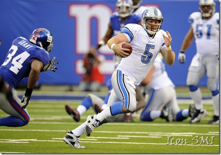 Drew Stanton, of the Detroit Lions, makes a fool of the New York Giants' Deon Grant