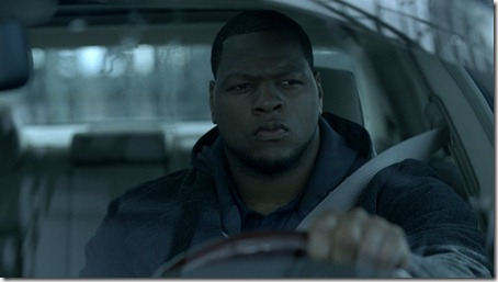 "Ndamukong Suh drives a Chrysler 300 in a new TV commercial, ""Homecoming."""