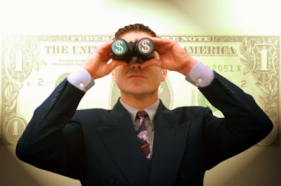 A corporate business man using a binocular to find money.