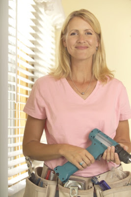 Blonde woman used low interest loans to cover home repairs.