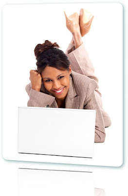 Business woman lying down next to a laptop smiling.