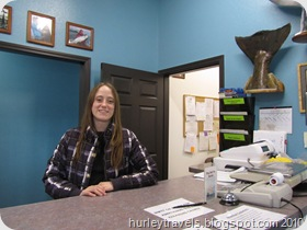 Friendly salesperson at fish processing center in Soldotna, AK