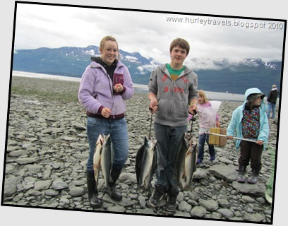 Young people with their salmon catches in Valdez, AK.