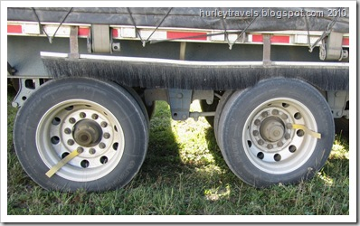 Markers on these tires help the truck driver know the axles on the trailer are turning.