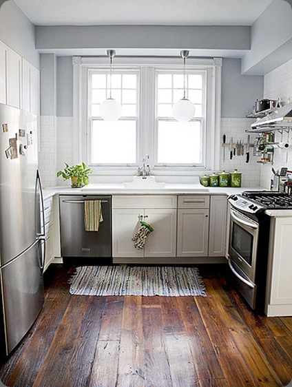 white-kitchen-cabinets-subway-tile-stainless-steel-appliances-blue-walls-plank-wood-floor the sweetest occasions