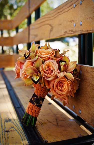 Dunifon_073 orange cymbidium orchids paired with the orange roses and asiatic lilies botanica