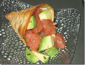 Grapefruit and avocado salad in a semolina cracker cone