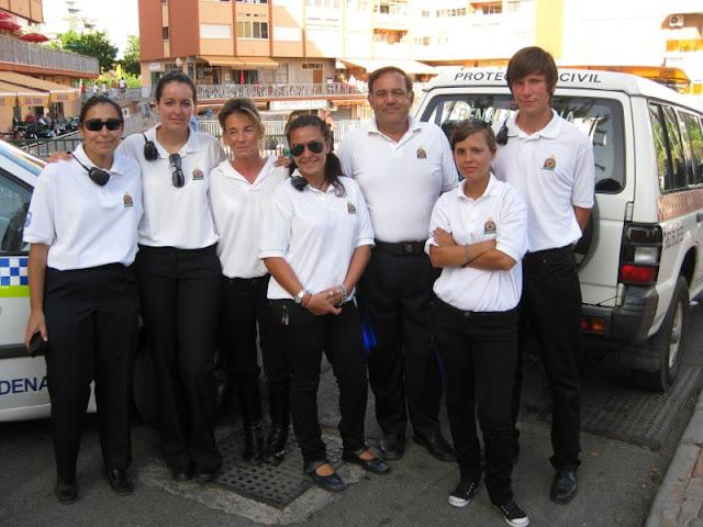 Equipo de voluntarios que escoltaron a la virgen durante su traslado desde la iglesia al puerto para su embarque.