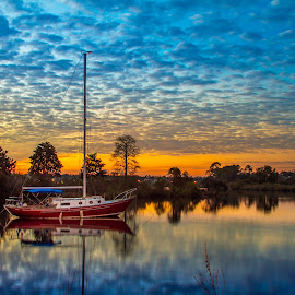 Red Sailboat by Jeannie Meyer - Transportation Boats ( gulfport, red, sunset, red sailboat, sailboat, mississippi )