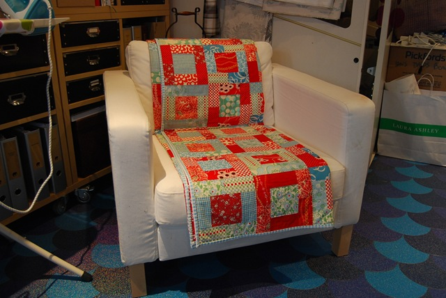 Chair with quilt