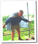 Tom balancing on the verandah-under-repair