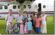 Keith and family on their recent visit to Rumginae in the twin otter
