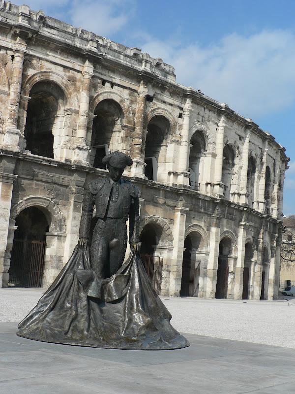 Toreador statue in front of coliseum
