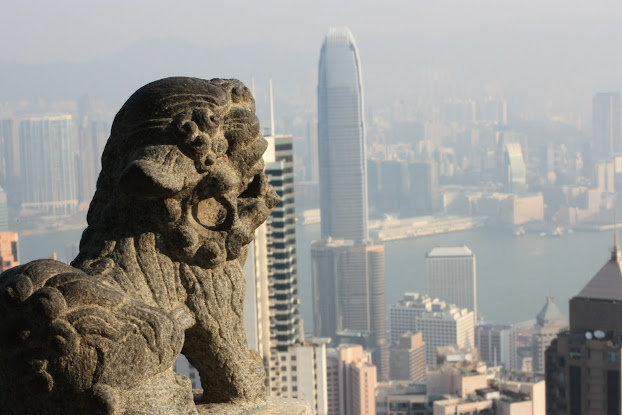 Lion overlooking Victoria Peak, with the IFC in the distance.