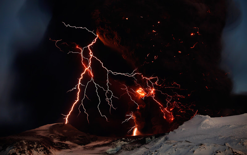 Lightning streaks across the sky as lava flows from a volcano in Eyjafjallajokul April 17, 2010. (REUTERS/Lucas Jackson)