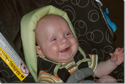smiling in the car seat