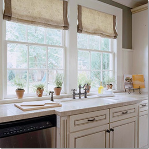 She used teastained roman shades in the kitchen and banded them using the