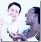interracial, black woman and white man drinking coffee and talking and laughing together