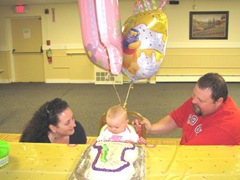 1st birthday Bella with mommy and daddy and cake
