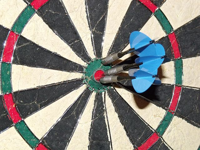 two darts in bull eye