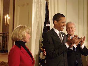 President Obama and Vice President Joe Biden lead applause for Lilly Ledbetter at the signing of the Fair Pay Act in January.