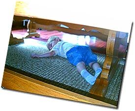Collin sleeping under table 002
