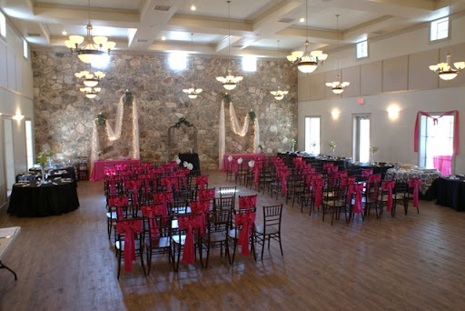 Their silk draped wedding arbor featured massive floral across the top with