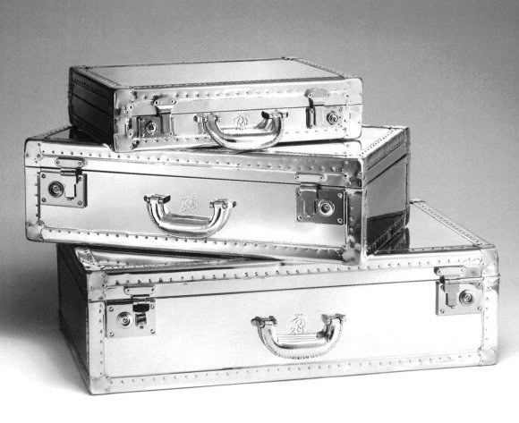 The Aluminum Suitcases