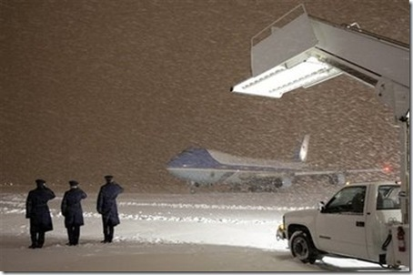 obama plane arrives in blizzard