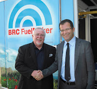 Gas Equipment Systems, Inc. president Larry Ozier with BRC GM Max Fissore (right) at NGV2010Roma, June's world natural gas vehicles meeting in Italy.
