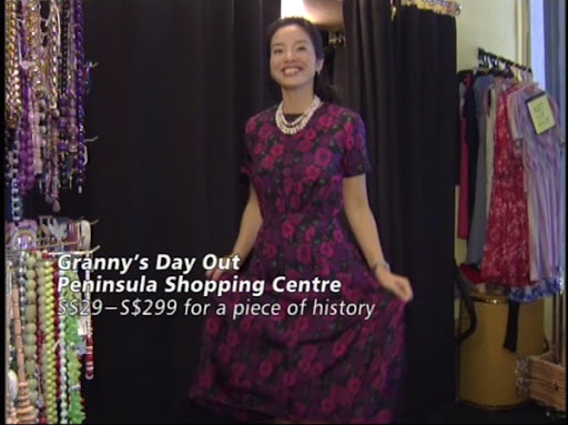 She practises a curtsy in a 50s floral number!