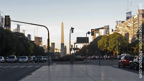 "El Obelisco the center of the ""Plaza de la República"" (Republic Square) at the intersection of ""Avenida Corrientes"" and ""Avenida 9 Julio"", the world's biggest avenue, in Buenos Aires at sunset"