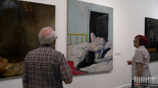 Couple in Front of a Coitus on Canvas by Pablo Suarez in the Centro Cultural Borges Buenos Aires, Argentina