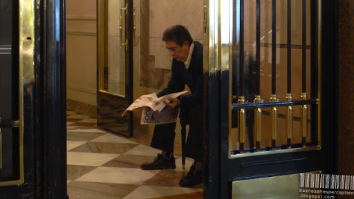 Concierge is Reading the Newspaper in the Entrance of a Residential Building in Buenos Aires, Argentina