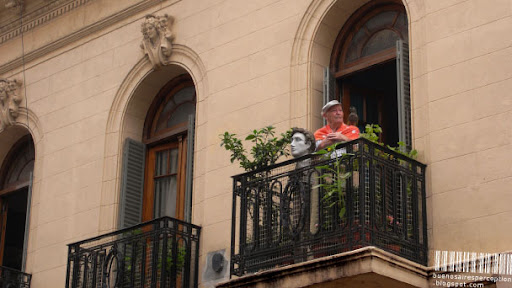 Portrait of a Gentleman with a Parrot standing on a Balcony in Buenos Aires, Argentina