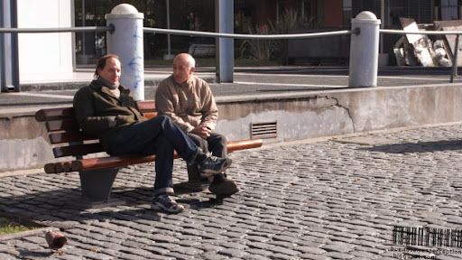 Argentinean Men Sitting on a Bench in Puerto Madero in Buenos Aires, Argentina