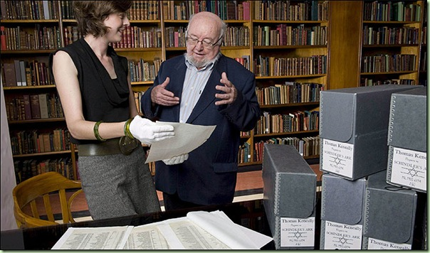 Author Thomas Keneally, right, and researcher Dr Olwen Pryke examine his old copy of Schindler&#39;s list