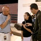 Durango Mexico Stadium Crusade Larry taking woman's testimony.jpg