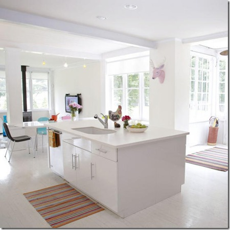 White bright airy open plan kitchen range cooker island unit dining area assorted colourful items art furniture sash windows real home L etc 09/2007 not used