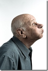 old man holding breath