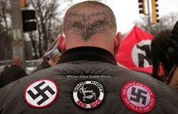Skinhead wears nazi symbols