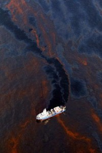 Boat cuts through oil slick