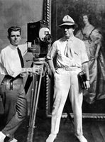 Old photo of two men with silent movie camera